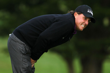 PEBBLE BEACH, CA - JUNE 18:  Phil Mickelson reacts to missed putt on the 14th green during the second round of the 110th U.S. Open at Pebble Beach Golf Links on June 18, 2010 in Pebble Beach, California.  (Photo by Donald Miralle/Getty Images)