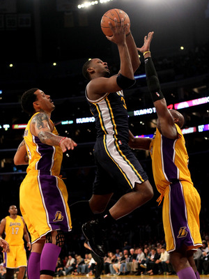 LOS ANGELES, CA - APRIL 05:  C.J. Miles #34 of the Utah Jazz shoots over Kobe Bryant #24 and Matt Barnes #9 of the Los Angeles Lakers at Staples Center on April 5, 2011 in Los Angeles, California. The Jazz won 86-85.  NOTE TO USER: User expressly acknowle