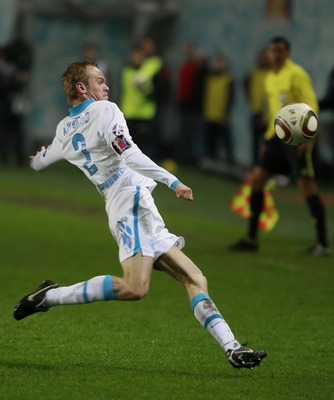 KHIMKI, RUSSIA - APRIL 28: Aleksandr Anyukov of FC Zenit St. Petersburg in action during the Russian Football League Championship match between PFC CSKA Moscow and FC Zenit St. Petersburg at the Khimki Stadium on April 28, 2010 in Khimki, Russia.  (Photo