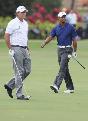 DORAL, FL - MARCH 10:  Tiger Woods (R) and Phil Mickelson watch a shot on the tenth hole during the first round of the 2011 WGC- Cadillac Championship at the TPC Blue Monster at the Doral Golf Resort and Spa on March 10, 2011 in Doral, Florida.  (Photo by