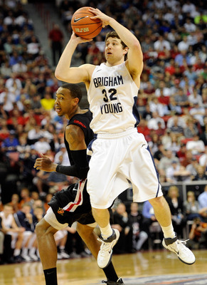 LAS VEGAS, NV - MARCH 12:  Jimmer Fredette #32 of the Brigham Young University Cougars shoots against Malcolm Thomas #4 of the San Diego State Aztecs during the championship game of the Conoco Mountain West Conference Basketball tournament at the Thomas &