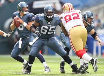 SEATTLE - SEPTEMBER 12:  Quarterback Matt Hasselbeck #8 of the Seattle Seahawks drops back to pass as Chris Spencer #65 and Ben Hamilton #50 defend against Aubrayo Franklin #92 of the San Francisco 49ers during the NFL season opener against at Qwest Field