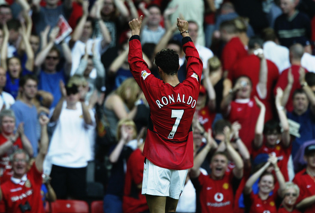 MANCHESTER - AUGUST 16:  Cristiano Ronaldo of Manchester United salutes the fans during the FA Barclaycard Premiership match between Manchester United and Bolton Wanderers held on August 16, 2003 at Old Trafford, in Manchester, England. Manchester United