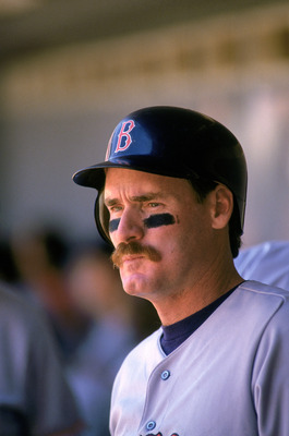 ANAHEIM, CA - 1991:   Wade Boggs #26 of the Boston Red Sox looks out of the dugout during a game against the California Angels in 1991 at Anaheim Stadium in Anaheim, California.  (Photo by: Ken Levine/Gettyimages)