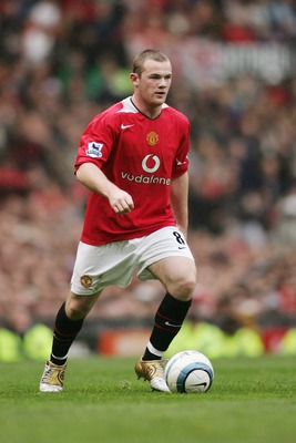 MANCHESTER, ENGLAND - OCTOBER 3:  Wayne Rooney of Manchester United runs with the ball during the FA Barclaycard Premiership match between Manchester United and Middlesbrough at Old Trafford on October 3, 2004 in Manchester, England.  (Photo by Michael St