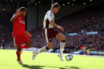 LIVERPOOL, ENGLAND - SEPTEMBER 25: Jordan Henderson of Sunderland ín action with Glen  Johnson of Liverpool during the Barclays Premier League match between Liverpool and Sunderland at at Anfield on September 25, 2010 in Liverpool, England.  (Photo by Cli