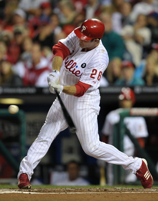 PHILADELPHIA, PA - JUNE 14: Chase Utley #26 of the Philadelphia Phillies hits a two run home-run in the bottom of the third inning during the game against the Florida Marlins at Citizens Bank Park on June 14, 2011 in Philadelphia, Pennsylvania. (Photo by
