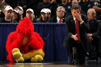 DENVER, CO - MARCH 17:  Head coach Rick Pitino of the Louisville Cardinals and the teams mascot react after a play while playing against the Morehead State Eagles during the second round of the 2011 NCAA men's basketball tournament at Pepsi Center on Marc