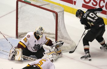 ROSEMONT, IL - JUNE 10: Ondrej Pavelec #19 of the Chicago Wolves guards the net against Luca Caputi #19 of the Wilkes-Barre/Scranton Penguins during the Calder Cup Finals on June 10, 2008 at the Allstate Arena in Rosemont, Illinois. The Wolves defeated th