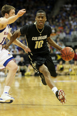 KANSAS CITY, MO - MARCH 11:  Alec Burks #10 of the Colorado Buffaloes drives with the ball against the Kansas Jayhawks during their semifinal game in the 2011 Phillips 66 Big 12 Men's Basketball Tournament at Sprint Center on March 11, 2011 in Kansas City