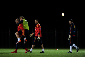 POTCHEFSTROOM, SOUTH AFRICA - JUNE 12: Sergio Ramos (2nd L) of Spain jokes with goalkeeper Pepe Reina (L) as goalkeepers Victor Valdes (2nd R) and Iker Casillas look on during a training session on June 12, 2010 in Potchefstroom, South Africa.  (Photo by