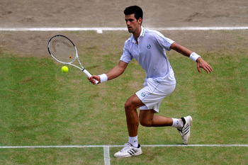LONDON, ENGLAND - JULY 02:  Novak Djokovic of Serbia plays a shot during the Men's Semi Final match against Tomas Berdych of Czech Republic on Day Eleven of the Wimbledon Lawn Tennis Championships at the All England Lawn Tennis and Croquet Club on July 2,