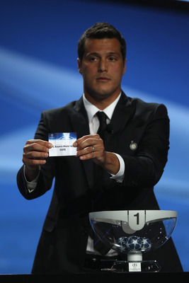 MONACO - AUGUST 26:  Julio Cesar of Inter Milan and Brazil draws the name of Bayern Munich during the UEFA Champions League Group Stage draw at the Grimaldi Forum on August 26, 2010 in Monaco, Monaco.  (Photo by Michael Steele/Getty Images)