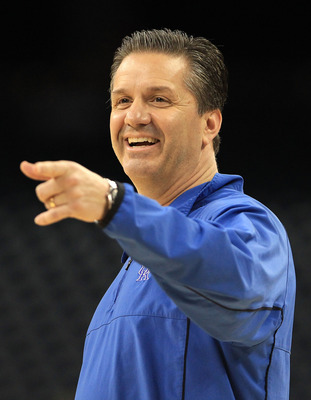 HOUSTON, TX - APRIL 01:  Head coach John Calipari of the Kentucky Wildcats points during practice prior to the 2011 Final Four of the NCAA Division I Men's Basketball Tournament at Reliant Stadium on April 1, 2011 in Houston, Texas.  (Photo by Streeter Le
