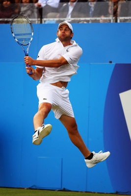 LONDON, ENGLAND - JUNE 10:  Andy Roddick of the United States jumps for the return during his Men's Singles quarter final match against Fernando Verdasco of Spain on day five of the AEGON Championships at Queens Club on June 10, 2011 in London, England.