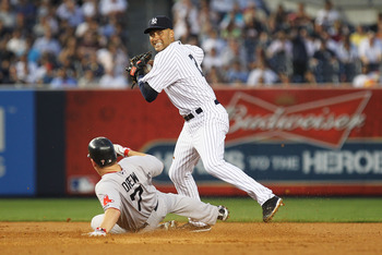 NEW YORK, NY - JUNE 08:  Derek Jeter #2 of the New York Yankees gets the force out against J.D. Drew #7 of the Boston Red Sox during their game on June 8, 2011 at Yankee Stadium in the Bronx borough of New York City.  (Photo by Al Bello/Getty Images)
