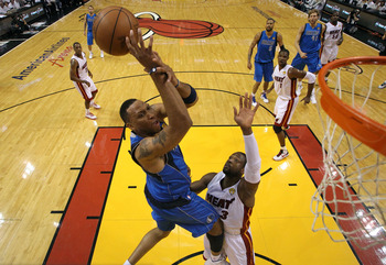 MIAMI, FL - JUNE 12:  Shawn Marion #0 of the Dallas Mavericks attempts a shot against Dwyane Wade #3 of the Miami Heat in the first quarter of Game Six of the 2011 NBA Finals at American Airlines Arena on June 12, 2011 in Miami, Florida. NOTE TO USER: Use