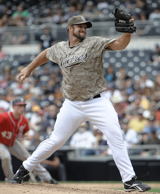 SAN DIEGO, CA - JUNE 12: Heath Bell #21 of the San Diego Padres pitches during the ninth inning of a baseball game against the Washington Nationals at Petco Park on June 12, 2011 in San Diego, California.  The Nationals won 2-0.  (Photo by Denis Poroy/Get