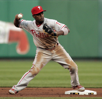 PITTSBURGH - JUNE 03:  Jimmy Rollins #11 of the Philadelphia Phillies turns a double play against the Pittsburgh Pirates during the game on June 3, 2011 at PNC Park in Pittsburgh, Pennsylvania. The Pirates defeated the Phillies 2-1 in extra innings.  (Pho