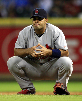 HOUSTON - JUNE 07:  First baseman Albert Pujols #5 of the St. Louis Cardinals takes a break during a pitching change against the Houston Astros at Minute Maid Park on June 7, 2011 in Houston, Texas.  (Photo by Bob Levey/Getty Images)