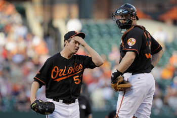 BALTIMORE, MD - JUNE 03:  Starting pitcher Zach Britton #53 of the Baltimore Orioles talks with catcher Matt Wieters #32 after giving up a run in the second inning to the Toronto Blue Jays at Oriole Park at Camden Yards on June 3, 2011 in Baltimore, Maryl