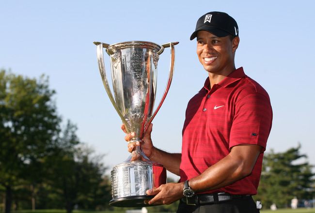 LEMONT, IL - SEPTEMBER 13: Tiger Woods holds the J.K. Wadley trophy after winning the BMW Championship at Cog Hill Golf & Country Club on September 13, 2009 in Lemont, Illinois. (Photo by Hunter Martin/Getty Images)