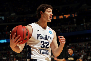 DENVER, CO - MARCH 17:  Jimmer Fredette #32 of the Brigham Young Cougars reacts to a call while playing against the Wofford Terriers during the second round of the 2011 NCAA men's basketball tournament at Pepsi Center on March 17, 2011 in Denver, Colorado