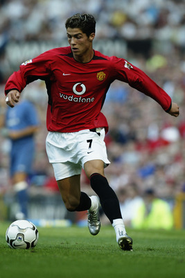 MANCHESTER - AUGUST 16:  Cristiano Ronaldo of Manchester United makes his debut for his new club during the FA Barclaycard Premiership match between Manchester United and Bolton Wanderers held on August 16, 2003 at Old Trafford, in Manchester, England. Ma