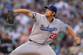 DENVER, CO - JUNE 09:  Starting pitcher Clayton Kershaw #22 of the Los Angeles Dodgers delivers against the Colorado Rockies at Coors Field on June 9, 2011 in Denver, Colorado.  (Photo by Doug Pensinger/Getty Images)