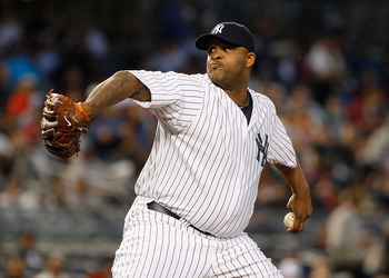 NEW YORK - JUNE 14:  CC Sabathia #52 of the New York Yankees delivers a pitch against the Texas Rangers on June 14, 2011 at Yankee Stadium in the Bronx borough of New York City.  (Photo by Mike Stobe/Getty Images)