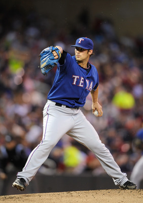 MINNEAPOLIS, MN - JUNE 10: C.J. Wilson #36 of the Texas Rangers pitches against the Minnesota Twins during the first inning of their game on June 10, 2011 at Target Field in Minneapolis, Minnesota. (Photo by Hannah Foslien/Getty Images)