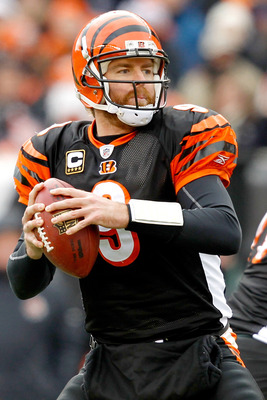 CINCINNATI, OH - DECEMBER 19:  Quarterback Carson Palmer #9 of the Cincinnati Bengals fades back in the pocket while playing the Cleveland Browns at Paul Brown Stadium on December 19, 2010 in Cincinnati, Ohio.  (Photo by Matthew Stockman/Getty Images)