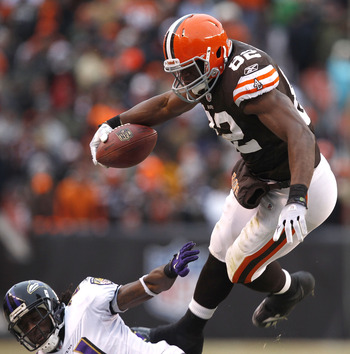 CLEVELAND - DECEMBER 26:  Cornerback Lardarius Webb #21 of the Baltimore Ravens hits tight end Benjamin Watson #82 of the Cleveland Browns at Cleveland Browns Stadium on December 26, 2010 in Cleveland, Ohio.  (Photo by Matt Sullivan/Getty Images)