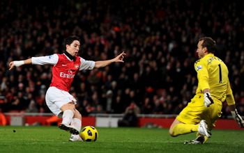 LONDON, ENGLAND - DECEMBER 04: Samir Nasri of Arsenal takes the ball past Fulham goalkeeper Mark Schwarzer to score the winning goal during the Barclays Premier League match between Arsenal and Fulham at the Emirates Stadium on December 4, 2010 in London,