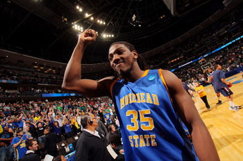 DENVER, CO - MARCH 17:  Kenneth Faried #35 of the Morehead State Eagles celebrates after defeating the Louisville Cardinals during the second round of the 2011 NCAA men's basketball tournament at Pepsi Center on March 17, 2011 in Denver, Colorado. The Mor