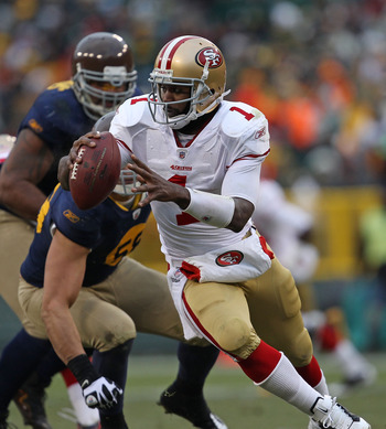 GREEN BAY, WI - DECEMBER 05: Troy Smith #1 of the San Francisco 49ers rolls out against the Green Bay Packers at Lambeau Field on December 5, 2010 in Green Bay, Wisconsin. The Packers defeated the 49ers 34-16. (Photo by Jonathan Daniel/Getty Images)