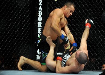 LOS ANGELES, CA - OCTOBER 24:  UFC fighter Gleison Tibau (top) battles with UFC fighter Josh Neer during their Lightweight 'Swing' bout at UFC 104: Machida vs. Shogun at Staples Center on October 24, 2009 in Los Angeles, California.  (Photo by Jon Kopalof