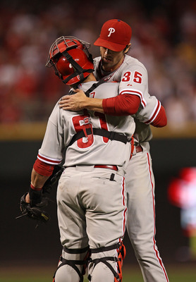 CINCINNATI - OCTOBER 10: Cole Hamels #35 of the Philadelphia Phillies hugs Carlos Ruiz #51 after throwing a complete game shut-out against the Cincinnati Reds during game 3 of the NLDS at Great American Ball Park on October 10, 2010 in Cincinnati, Ohio. T