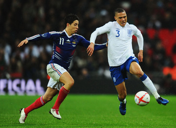 LONDON, ENGLAND - NOVEMBER 17:  Kieran Gibbs of England evades Samir Nasri of France during the international friendly match between England and France at Wembley Stadium on November 17, 2010 in London, England.  (Photo by Mike Hewitt/Getty Images)