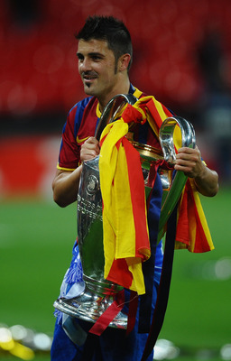 LONDON, ENGLAND - MAY 28:  David Villa of FC Barcelona poses with te trophy after victory in the UEFA Champions League final between FC Barcelona and Manchester United FC at Wembley Stadium on May 28, 2011 in London, England.  (Photo by Laurence Griffiths