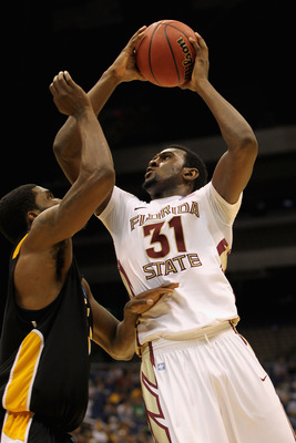 SAN ANTONIO, TX - MARCH 25:  Chris Singleton #31 of the Florida State Seminoles puts up a shot against Jamie Skeen #21 of the Virginia Commonwealth Rams during the southwest regional of the 2011 NCAA men's basketball tournament at the Alamodome on March 2