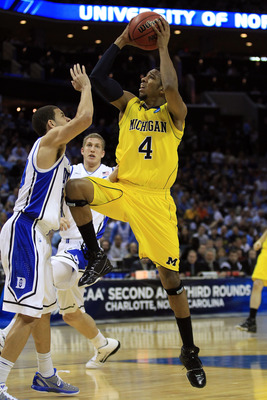 CHARLOTTE, NC - MARCH 20:  Darius Morris #4 of the Michigan Wolverines goes up for a shot against Seth Curry #30 of the Duke Blue Devils during the third round of the 2011 NCAA men's basketball tournament at Time Warner Cable Arena on March 20, 2011 in Ch