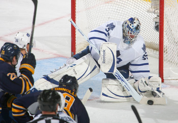 BUFFALO, NY - FEBRUARY 16: Jean-Sebastien Giguere #35 of the Toronto Maple Leafs covers up on a shot by Tim Connolly #19 of the Buffalo Sabres  at HSBC Arena on February 16, 2011 in Buffalo, New York.  (Photo by Rick Stewart/Getty Images)