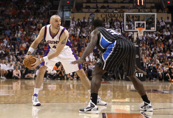 PHOENIX, AZ - MARCH 13:  Marcin Gortat #4 of the Phoenix Suns looks to pass the ball against the Orlando Magic during the NBA game at US Airways Center on March 13, 2011 in Phoenix, Arizona.  NOTE TO USER: User expressly acknowledges and agrees that, by d