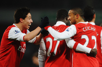LONDON, UNITED KINGDOM - MARCH 02:  Gael Clichy (R) of Arsenal celebrates with team mate Samir Nasri (L) after scoring his sides fifth goal during the FA Cup sponsored by E.ON 5th Round Replay match between between Arsenal and Leyton Orient at the Emirate