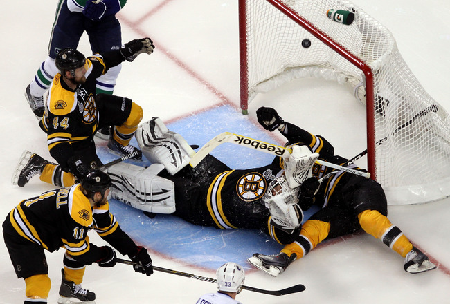 BOSTON, MA - JUNE 13:  Tim Thomas #30 of the Boston Bruins gets scored on by the Vancouver Canucks during Game Six of the 2011 NHL Stanley Cup Final at TD Garden on June 13, 2011 in Boston, Massachusetts.  (Photo by Jim Rogash/Getty Images)