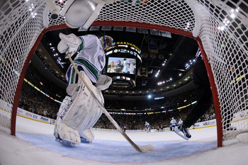 BOSTON, MA - JUNE 13:  Roberto Luongo #1 of the Vancouver Canucks looks on during Game Six against the Boston Bruins in the 2011 NHL Stanley Cup Final at TD Garden on June 13, 2011 in Boston, Massachusetts.  (Photo by Elsa/Getty Images)