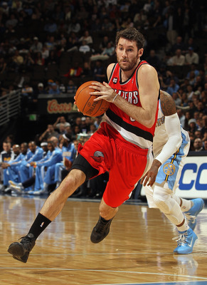 DENVER - DECEMBER 28:  Rudy Fernandez #5 of the Portland Trail Blazers dribbles the ball against the Denver Nuggets at Pepsi Center on December 28, 2010 in Denver, Colorado. The Nuggets defeated the Blazers 95-77. NOTE TO USER: User expressly acknowledges