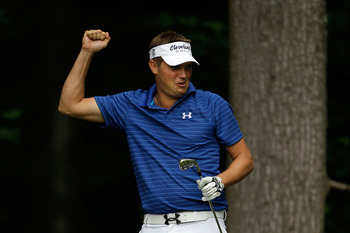 BETHESDA, MD - JUNE 14:  Jeff Overton celebrates a hole-in-one on the 13th hole during a practice round prior to the start of the 111th U.S. Open at Congressional Country Club on June 14, 2011 in Bethesda, Maryland.  (Photo by Rob Carr/Getty Images)