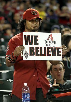 PHOENIX, AZ - JUNE 03: A fan of the Arizona Diamondbacks holds up a sign reading 'We Believe' during the Major League Baseball game against the Washington Nationals at Chase Field on June 3, 2011 in Phoenix, Arizona. The Diamondbacks defeated the National